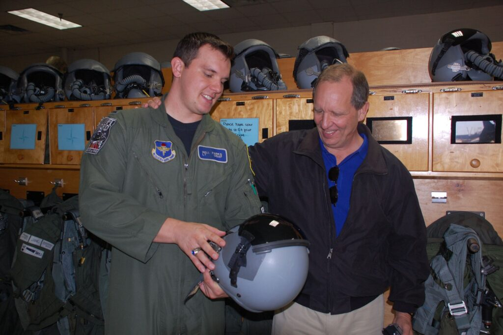 Dad checking out helmet in Life Support.