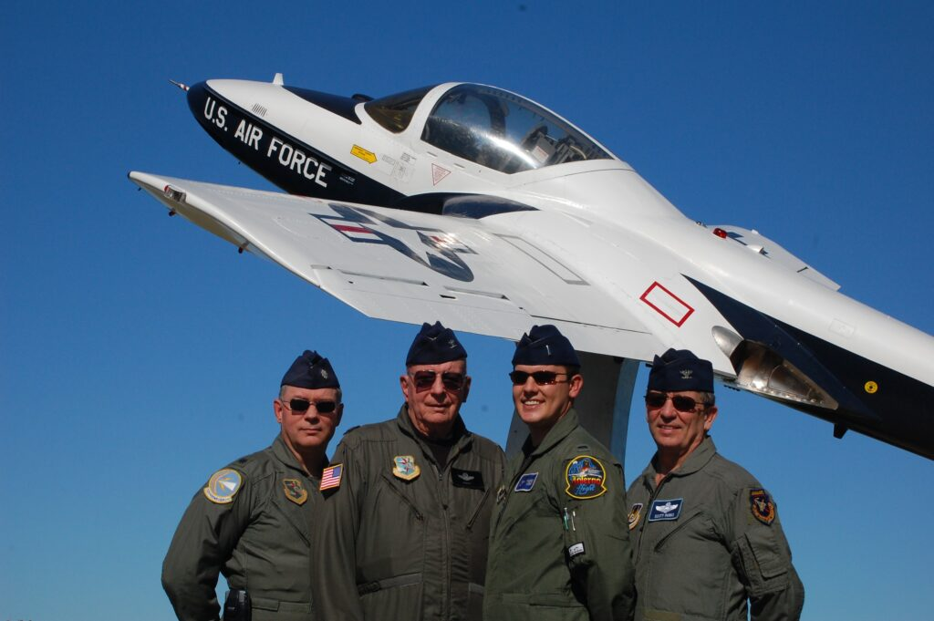 Grandpa, son, dad, uncle. Some of the old flight suits fit snug, but hey, who needs to breathe? This one in front of a T-37 flown in the first half of flight training.