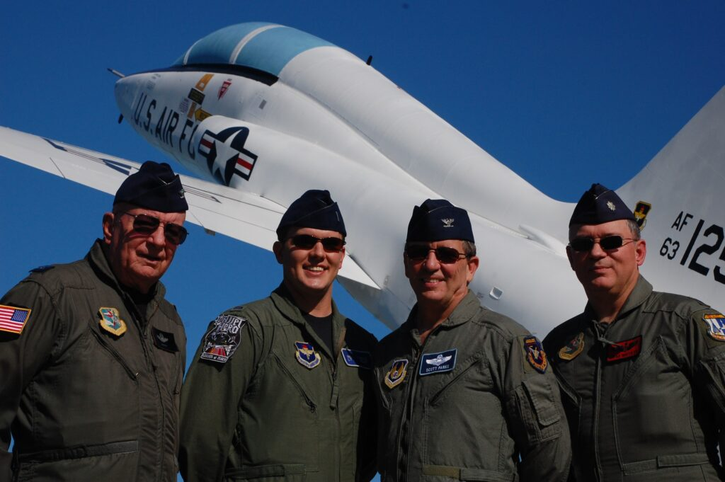 """Second photo in front of a T-38 flown in the second half of training (this varies depending on whether the student will be going into fighters or """"heavy"""" aircraft)."""