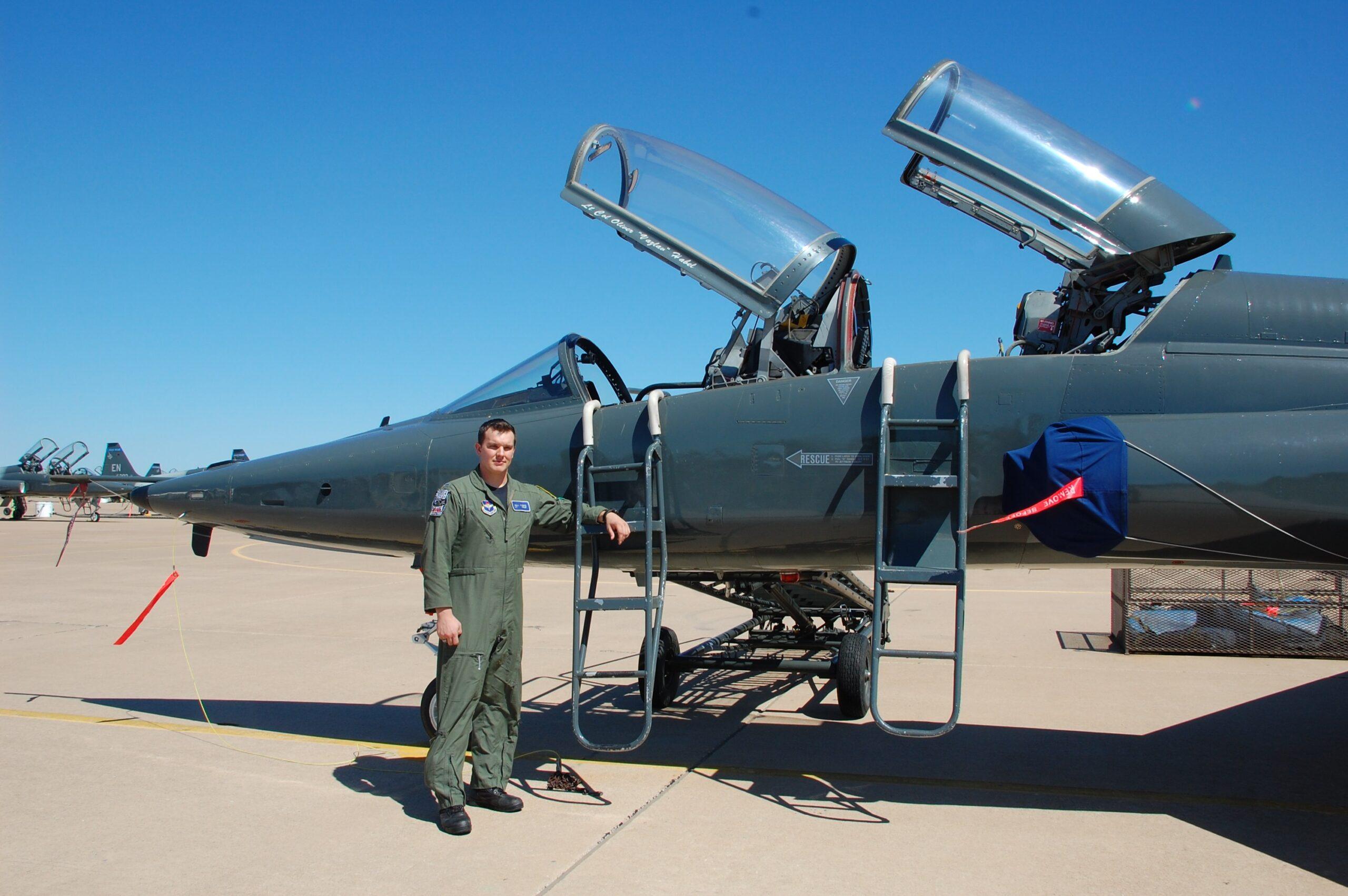 Son posing by plane