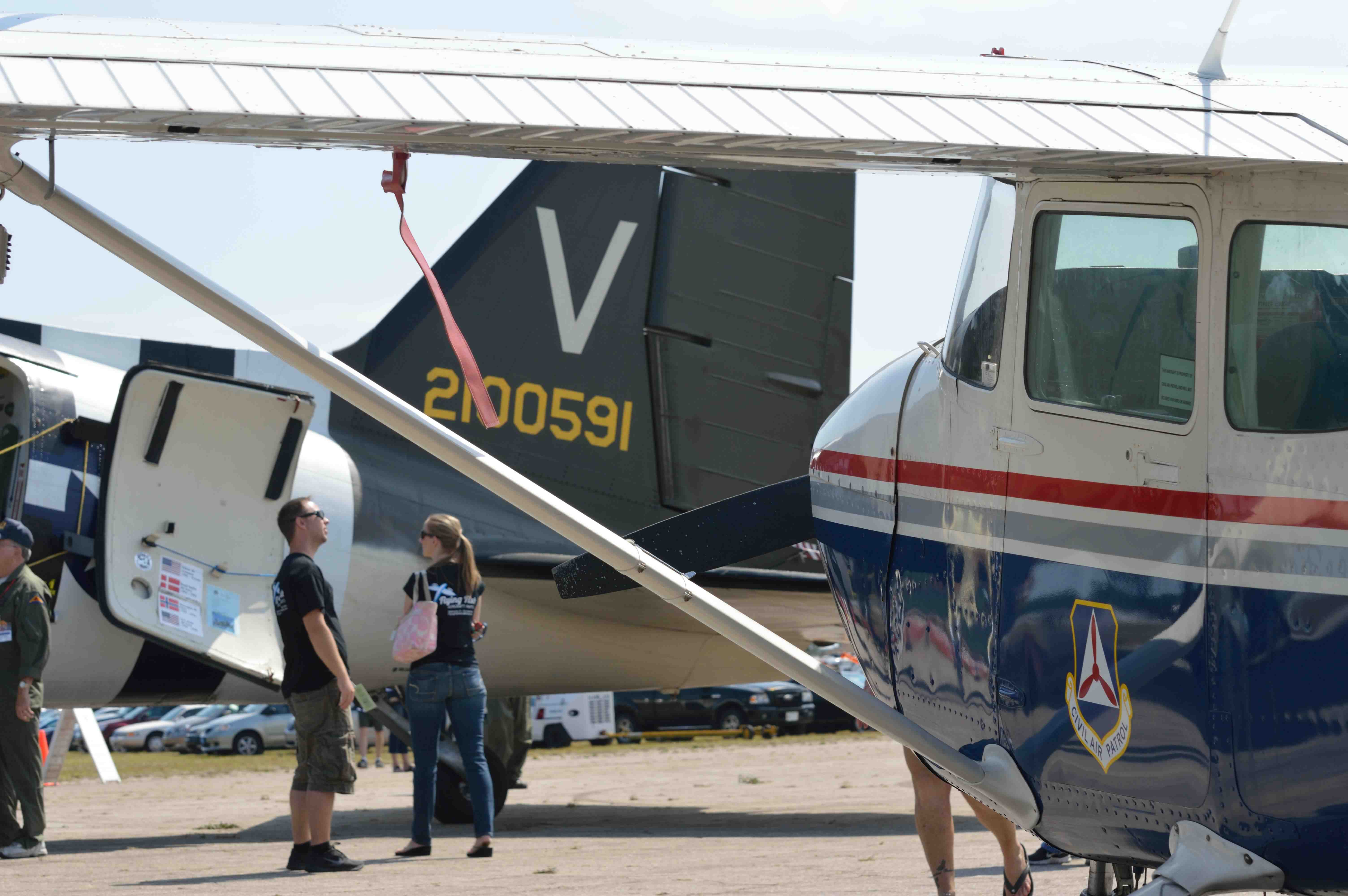 Civil Air Patrol worked together with the Valiant Air Command to help make the Airshow days run smoothly. The Tico Belle tail seen through the CAP aircraft strut.