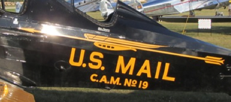 This upclose look at the Pitcairn Mailwing symbol from Wikipedeia and attributed to Photographer FlugKerl2, 25 July 2011, is from a PA-7s Mailwing. This one appears to be sport configuration with Mail paint scheme.