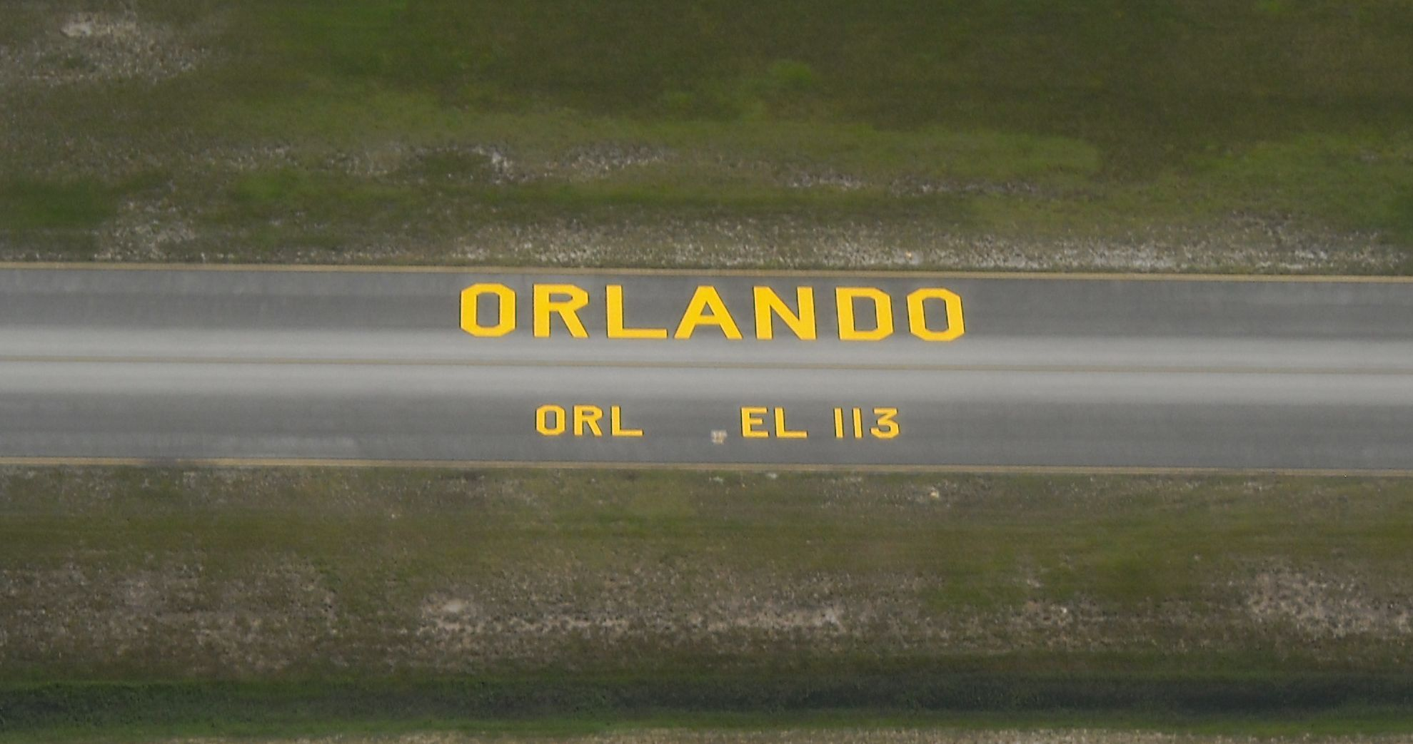 Air Marking of Taxiway A at Orlando Executive. Photo by pilot Bobbi Lasher, an active member of Spaceport Chapter of 99s with 21 years of flying.