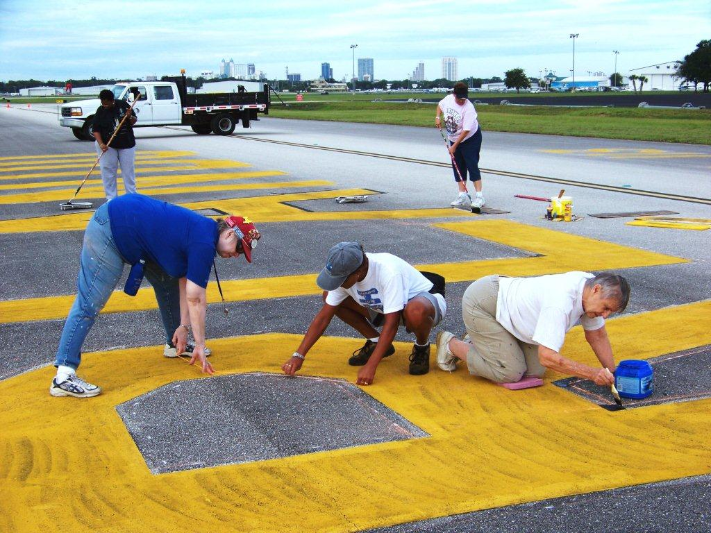 Measuring and painting letters and numbers at Orlando Executive Airport. Photo by Bobbi Lasher
