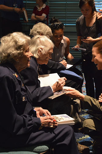 WASP signing books and booklets about their history.