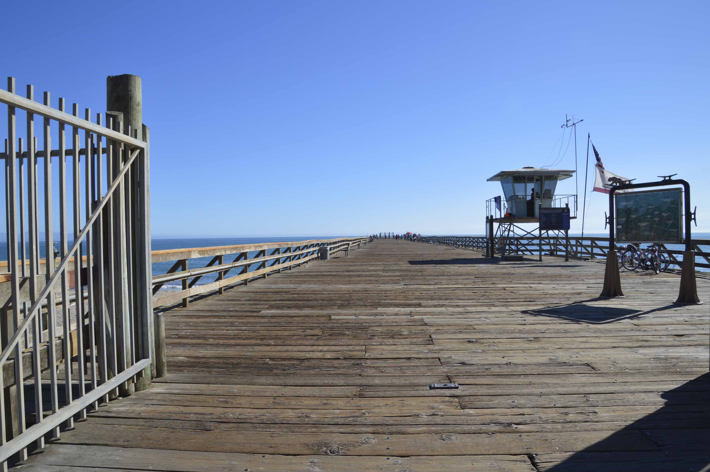 The Seacliff Beach entrance to the pier where people fish and sight-see.