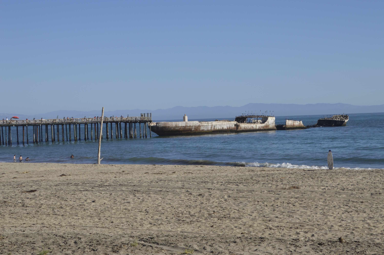 The wide beach, pier, and S.S. Palo Alto at Altos, California.
